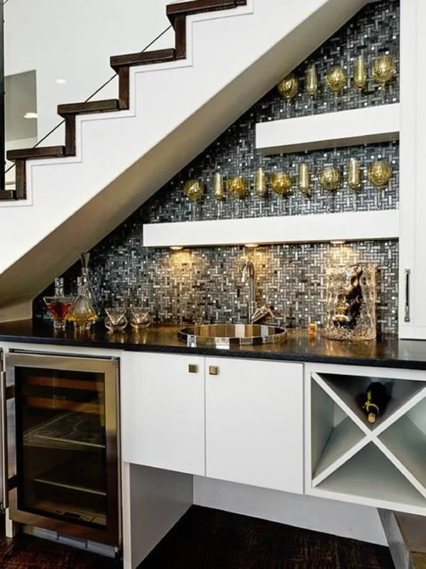 While the original article apartment therapy wrote including this bar was on tie work, we were especially impressed with the unique use of space in the staircase