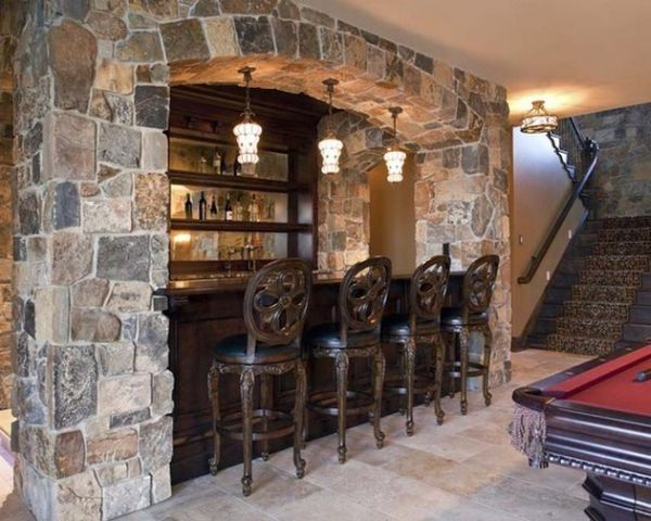 This exotic home bar caught our eye with it's exceptional stone work.