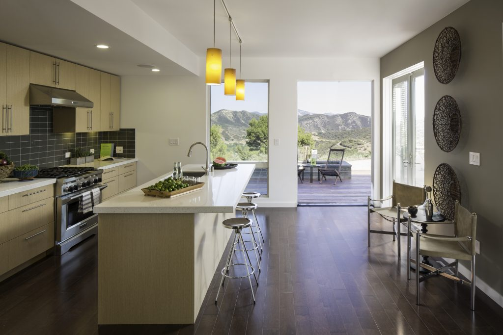 The layout of this modern and highly functional galley style kitchen has state-of-the-art appliances along one wall and clean up and prep on the island side. Open to the adjacent living room and accessible to the stunning outdoor views and patios, this Bluehome (link) kitchen designed by Courtney Lake (link) is the ideal set up for modern entertaining.
