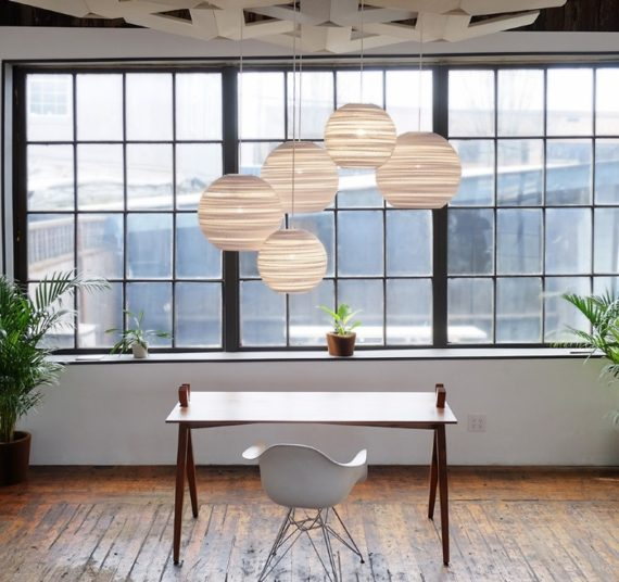 Graylight architectural fixtures are made of white cardboard and constructed in an environmentally aware envirnmet