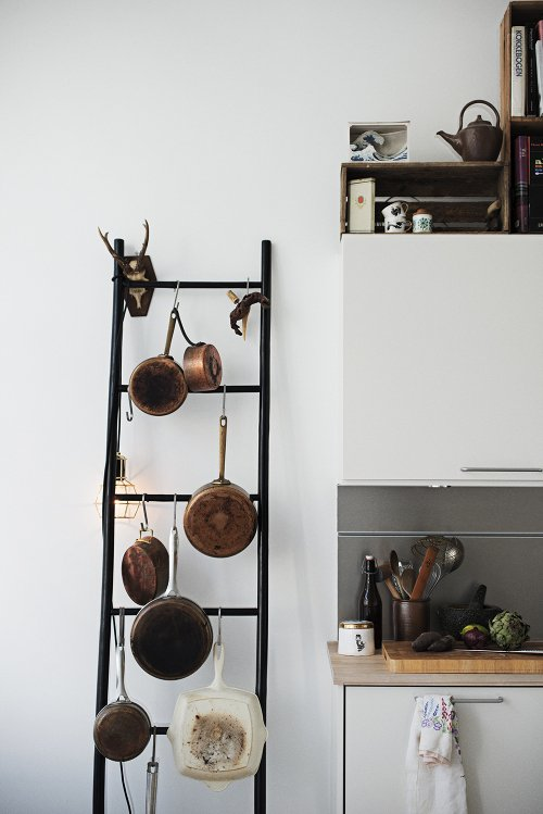Free standing pot rack ladder courtesy of Camilla Ebdrup on Design Sponge